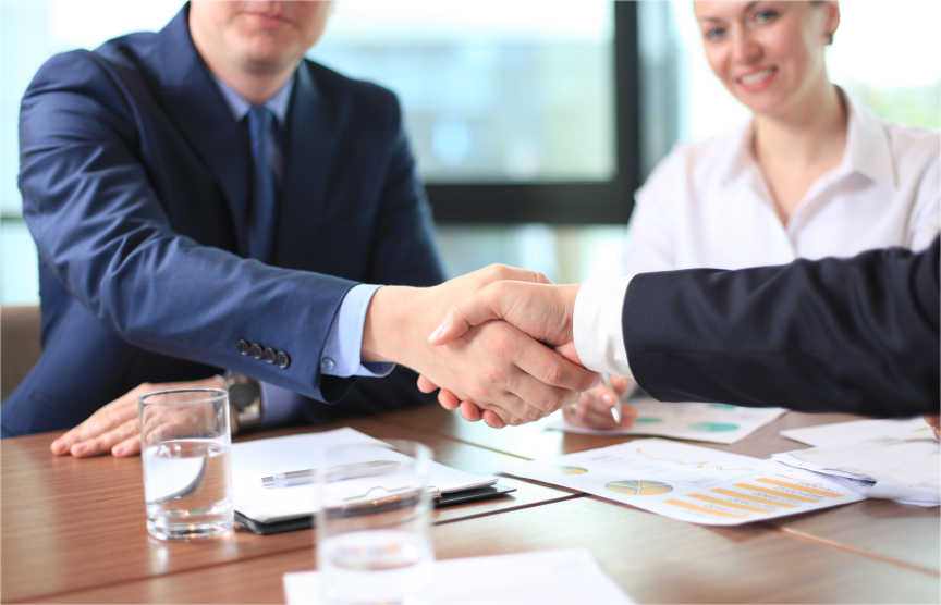 Business people shaking hands, finishing up a meeting with trustee & financial services